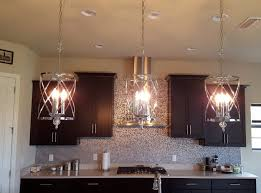 elk lighting chandelier with recessed lighting and wooden kitchen cabinet also rangehood for modern kitchen design