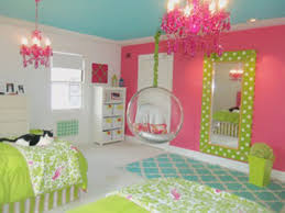 white pink wall connected by green bedding bed and white wooden