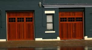i stumbled on these garage doors and thought they were interesting essentially they implement a man door in a working traditional garage door
