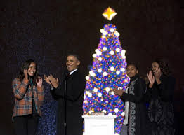President Barack Obama, First Lady Michelle Obama and their daughters Malia  (left) and