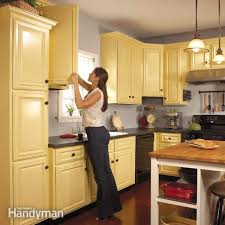 what kind of paint to use on kitchen cabinetsHow to Spray Paint Kitchen Cabinets  Family Handyman
