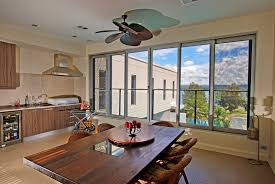 replace windows with doors glass doors open areas of wall space so natural daylight can flood the room consider replacing some windows with sliding doors