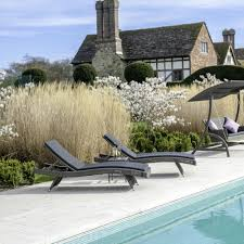 alexander rose monte carlo wave rattan sunlounger with cushion