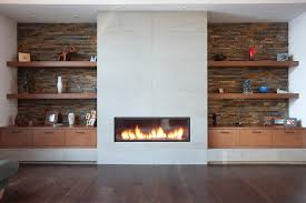 Modern fireplace with open shelving. Horizontal lines balance out the  vertical fireplace.