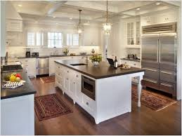 simple kitchen area rugs beach themed on hardwood flooring with large stainless refrigerator and hanging lights