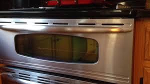 how to clean between oven door glass layers