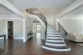 elegant wood staircase with wrought iron railing