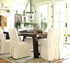 image of slip covered dining chairs family room slipcovers for round back vine