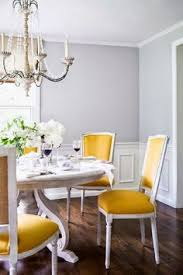 yellow upholstery gives this room all the color it needs