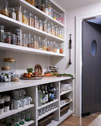 I have a Butlers pantry fetish.if that kitchen wall dosent come down.this  could be an alternative. Although for me open storage has its own problems.