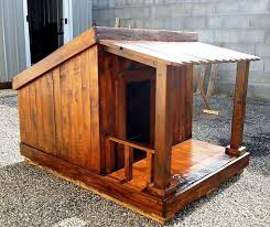 a wood dog house built from a free building plan