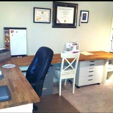ikea butcher block butcher block counter tops with desk pieces underneath still need new office chairs and to finish the wall decor ikea butcher block