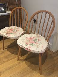 pair of ercol dining chairs vintage retro 50s 60s beech light wood seat pads 1 of 8 see more
