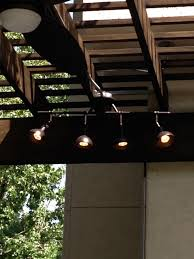 Outdoor Kitchen Lighting This Houston Outdoor Living Space Comprises A Covered Patio Via