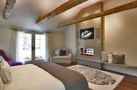view in gallery keeping the fireplace below the tv simple and contemporary