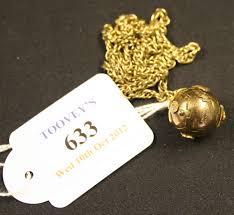 a masonic folding ball pendant fob opening to reveal engraved masonic symbols with a gilt metal nec