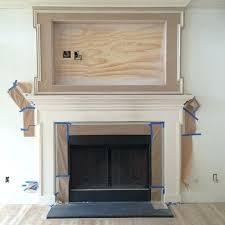framed tv over fireplace built in mantle is coming together framed tv over fireplace