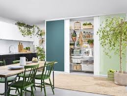 sliding doors help maximise the interior space of a pantry elfa available at the