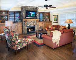 fireplace mantel diy living room traditional with tv above fireplace stone fireplace built in storage