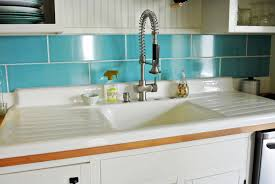 drop in white cast iron kitchen sink with single bowl and double drainboard also modern faucet