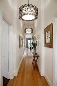 small hallway table. Nice Narrow Hall Table, Matching Frames, And Repeating Light Fixtures. Small Hallway Table .