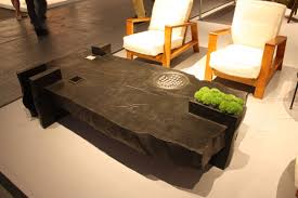 this sy table includes a planter and a game detail for interest