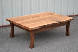 live edge white oak coffee table with curved walnut legs