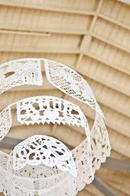 this is a papel picado banner turned into a chandelier you can diy or papel