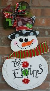 hand painted snowman door hanger by katelynnalainedesign on
