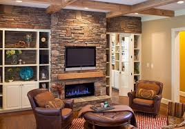 beauteous fireplace ideas with brick and stone wall panels exposed also tv mounted over shelves added rounded upholstery table and seater decors