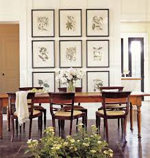 picture wall ideas 3 rows of 3 botanical prints as the backdrop for a dining