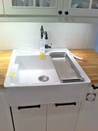 ikea white farmhouse kitchen sinks solid wood butcher block countertops beaded white cabinet panels