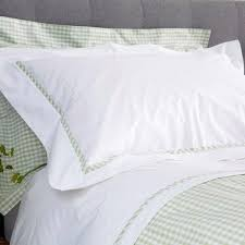 white pillowcase with green gingham trim