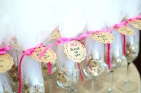 wedding shower favors bridal shower favors of champagne flutes filled with chocolate kisses tied with pink