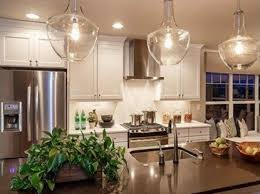new lighting trends. A Simple Kitchen, Nicely Decorated In Vineyard Design, Complete With Potted Plant New Lighting Trends NewHomeSource.com