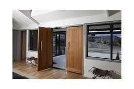 double timber entrance doors with designer handles and a roller catch