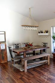 rustic reclaimed dining room with upcycled mason jar chandelier the summery umbrella featured on