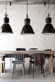 as you can see a warm woodsy natural feeling space is literally given a jolt of excitement by the repetitive use of striking light fixtures in all black