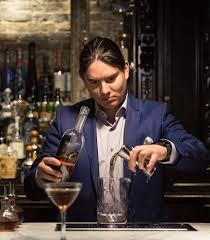 bartender bruno prado prepares a cocktail at yvonne s photograph by trevor reid