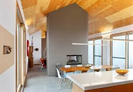 Interiors Cindy Rendely Architexture Kitchen Features Gray Tiled Double  Sided Wood Fireplace As Room Divider Also