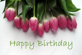Happy Birthday In Green Text With Bunch Of Pink Tulips Stock Photo