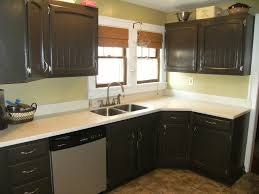 dark green painted kitchen cabinets. Dark Painted Kitchen Cabinets With Light Countertop And Window Roman Shades Square Ceramic Floor Tile Undermount Metal Sink Modern Faucet Green C