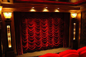 fantastic red velvet curtains over the screen in a home theater