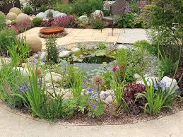 garden pond ideas. Unique Garden Garden Pond With Flowers And Shrubs Throughout Pond Ideas
