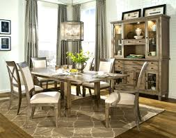 upholstered chairs create chic dining room