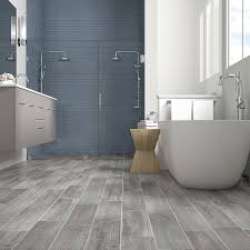 french blue shower tile with gray wood look floor tiles