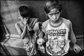 There is wide spread poverty in the Philippines  particularly in the    mega cities    such as Manila  These are photos of the children of people