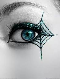 spider web eye makeup the glitter in this spider wed eyes makes the scary look more pretty add a bit of glitter with sleek dip it glitter liner