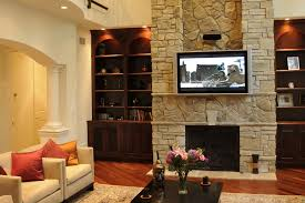 indoor stone fireplace ideas complete with led tv and wooden display cabinet include decoration objects