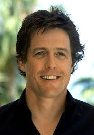 British actor Hugh Grant poses for photographers during a photocall in Cannes May 25, 2002 - 250162-british-actor-hugh-grant-poses-for-photographers-during-a-photocall-in